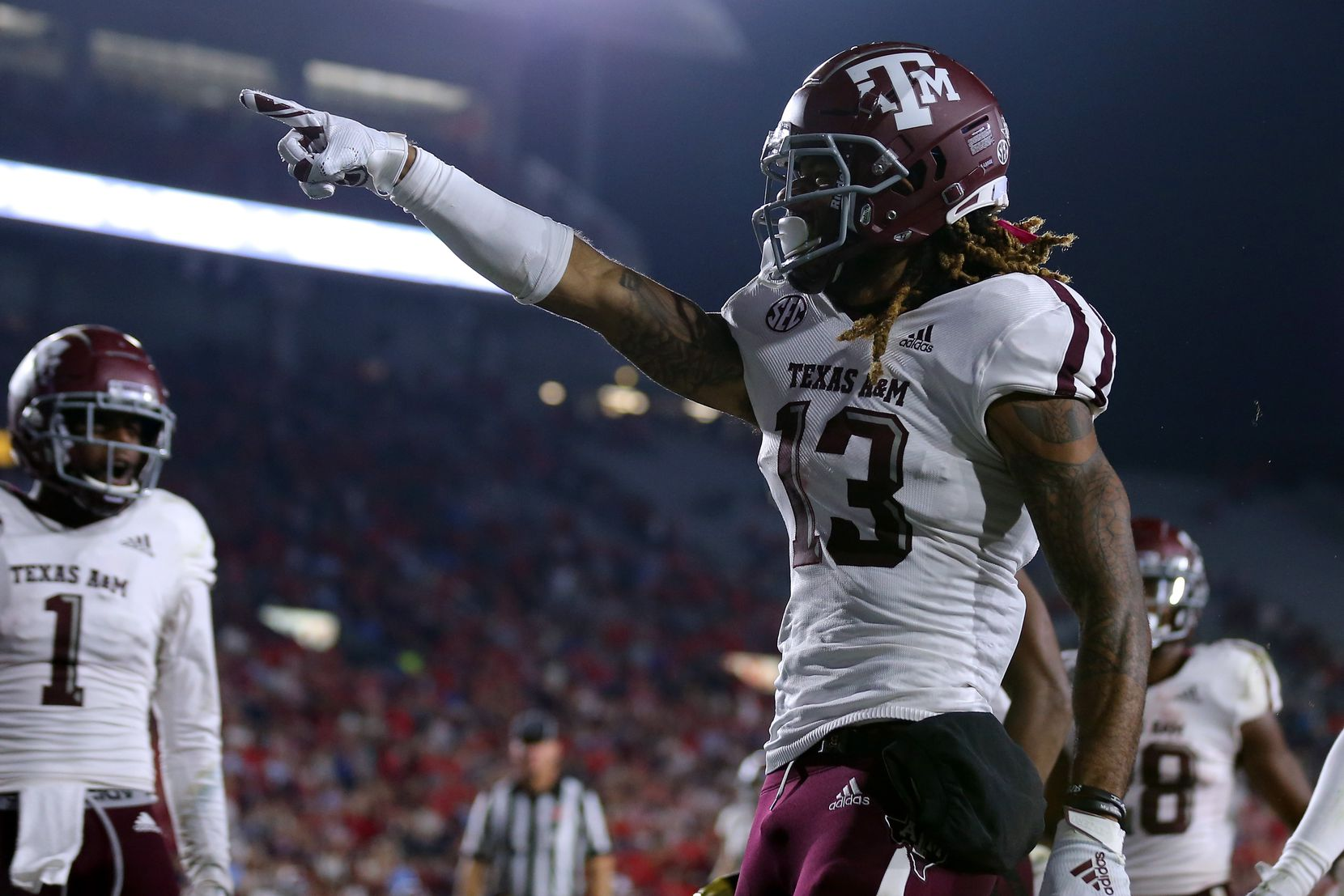 OXFORD, MISSISSIPPI - OCTOBER 19: Kendrick Rogers #13 of the Texas A&M Aggies celebrates a touchdown during the first half against the Mississippi Rebels at Vaught-Hemingway Stadium on October 19, 2019 in Oxford, Mississippi. (Photo by Jonathan Bachman/Getty Images)