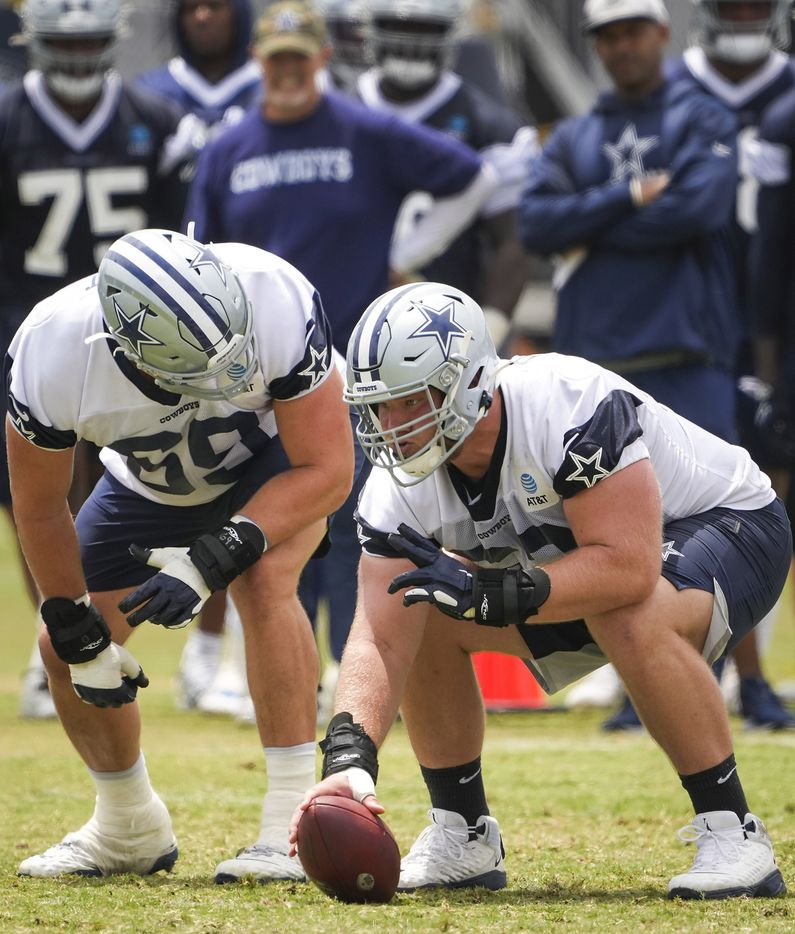 Dallas Cowboys guard Connor Williams (52) prepares to make a snap at center as he lines up with tackle Brandon Knight (69) during a practice at training camp on Sunday, July 25, 2021, in Oxnard, Calif.