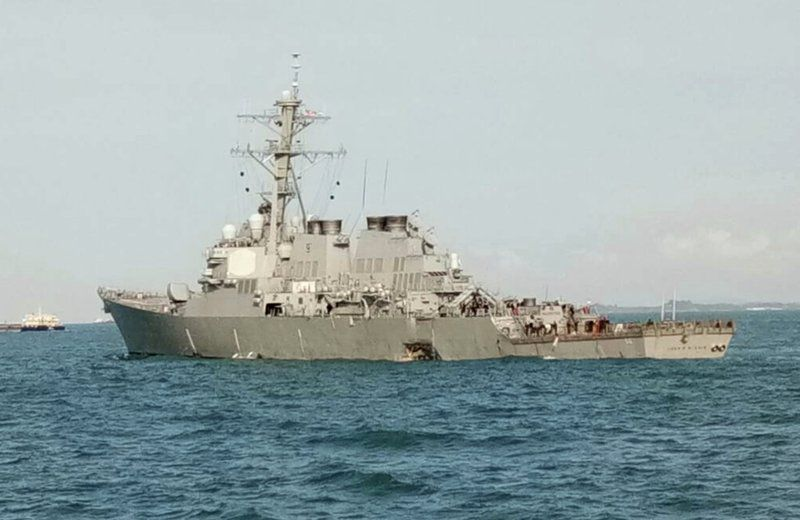 The U.S. guided-missile destroyer USS John S. McCain arrived in Singapore Monday following a collision off Johor, Malaysia, that left a gaping hole in the ship's port side. Ten sailors were reported missing.