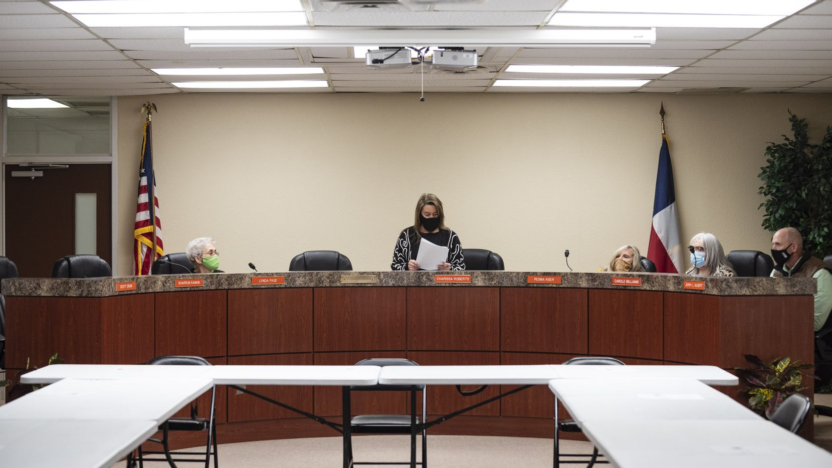 A Kemp ISD board president Charissa Roberts, center, prepares to conduct a board meeting at the district's admin building in Kemp, on Monday, Dec. 14, 2020. A Texas Education Agency investigation revealed a toxic culture within the Kemp ISD board. The dysfunction often resulted in using racist slurs by board members, threatening staff and engaging in contract procurement violations.
