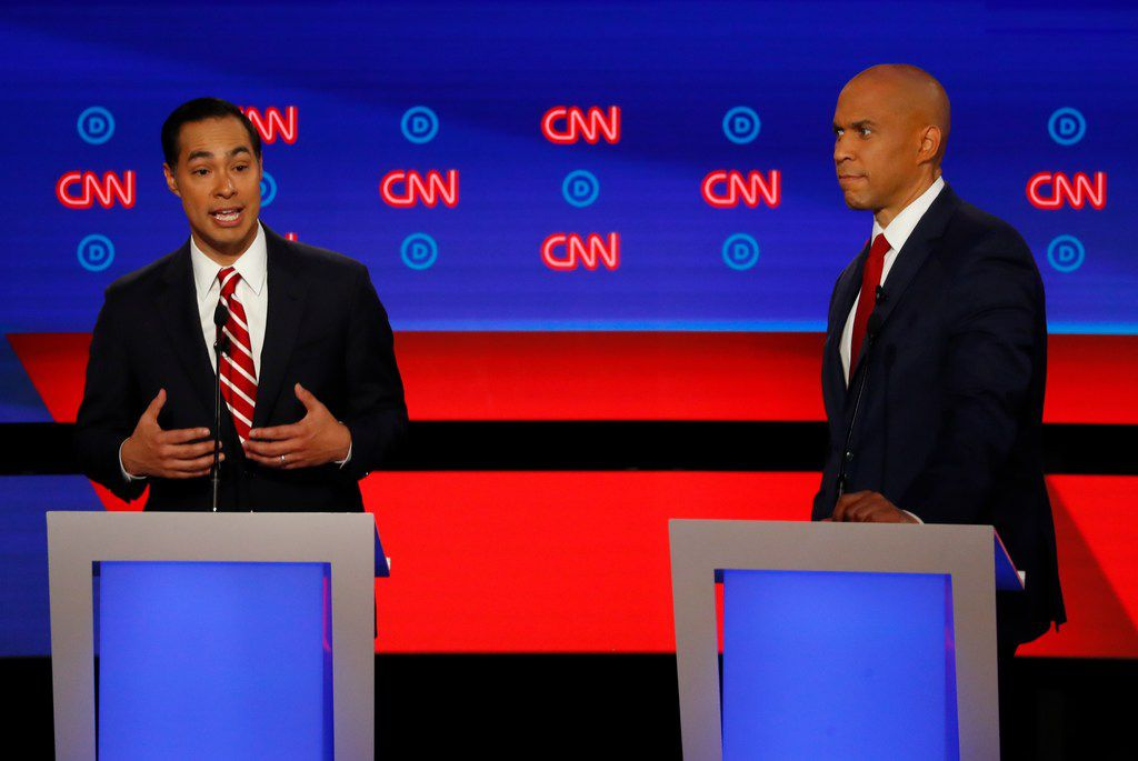 Former Housing and Urban Development Secretary Julian Castro speaks as Sen. Cory Booker, D-N.J. listens during the second of two Democratic presidential primary debates hosted by CNN Wednesday, July 31, 2019, in the Fox Theatre in Detroit. (AP Photo/Paul Sancya)