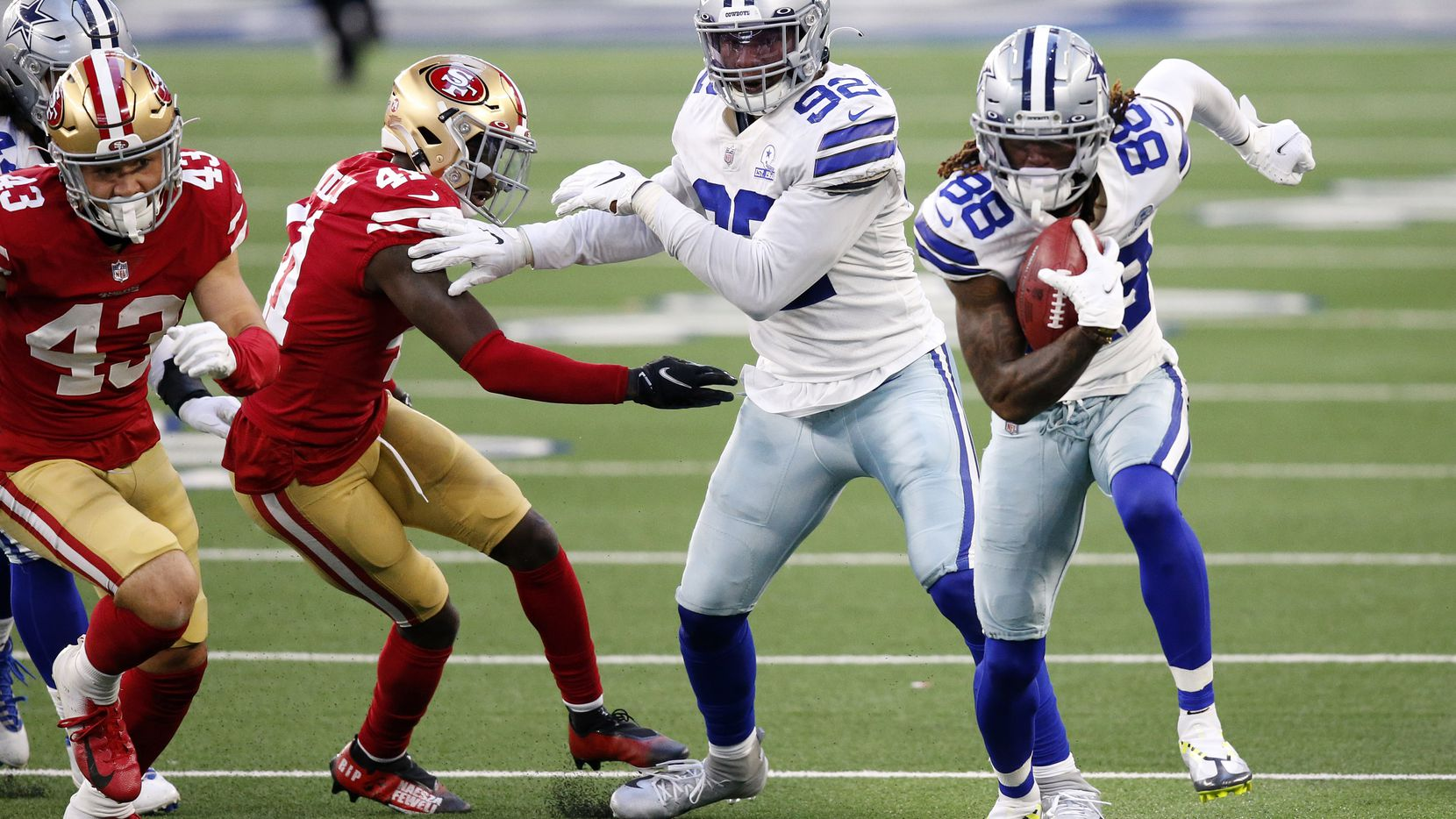 Dallas Cowboys wide receiver CeeDee Lamb (88) picks up an onside kick and races for a fourth quarter touchdown against the San Francisco 49ers at AT&T Stadium in Arlington, Texas, Sunday, December 20, 2020.