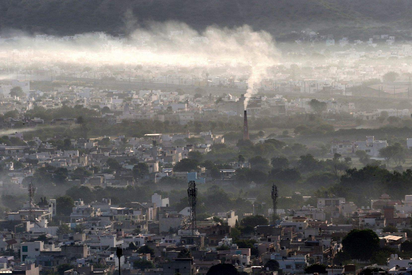 CO2 emissions began to increase late last year and into 2021 as vaccines began to foll out and coronavirus restrictions were lifted. Above, a factory in Ajmer, in northern India, belches smoke from its chimney.
