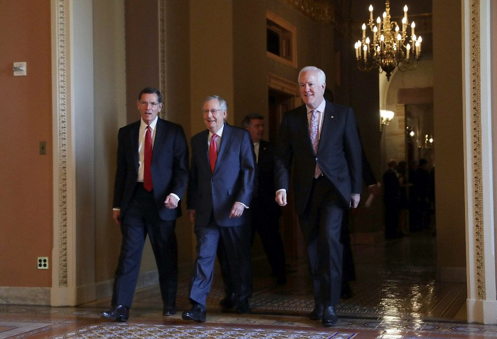 U.S. Sen. John Barrasso (R-WY), Senate Majority Leader Sen. Mitch McConnell (R-KY) and Senate Majority Whip John Cornyn (R-TX) leave after an election meeting of Senate Republicans at the Capitol November 16, 2016 in Washington, DC. (Photo by Alex Wong/Getty Images)