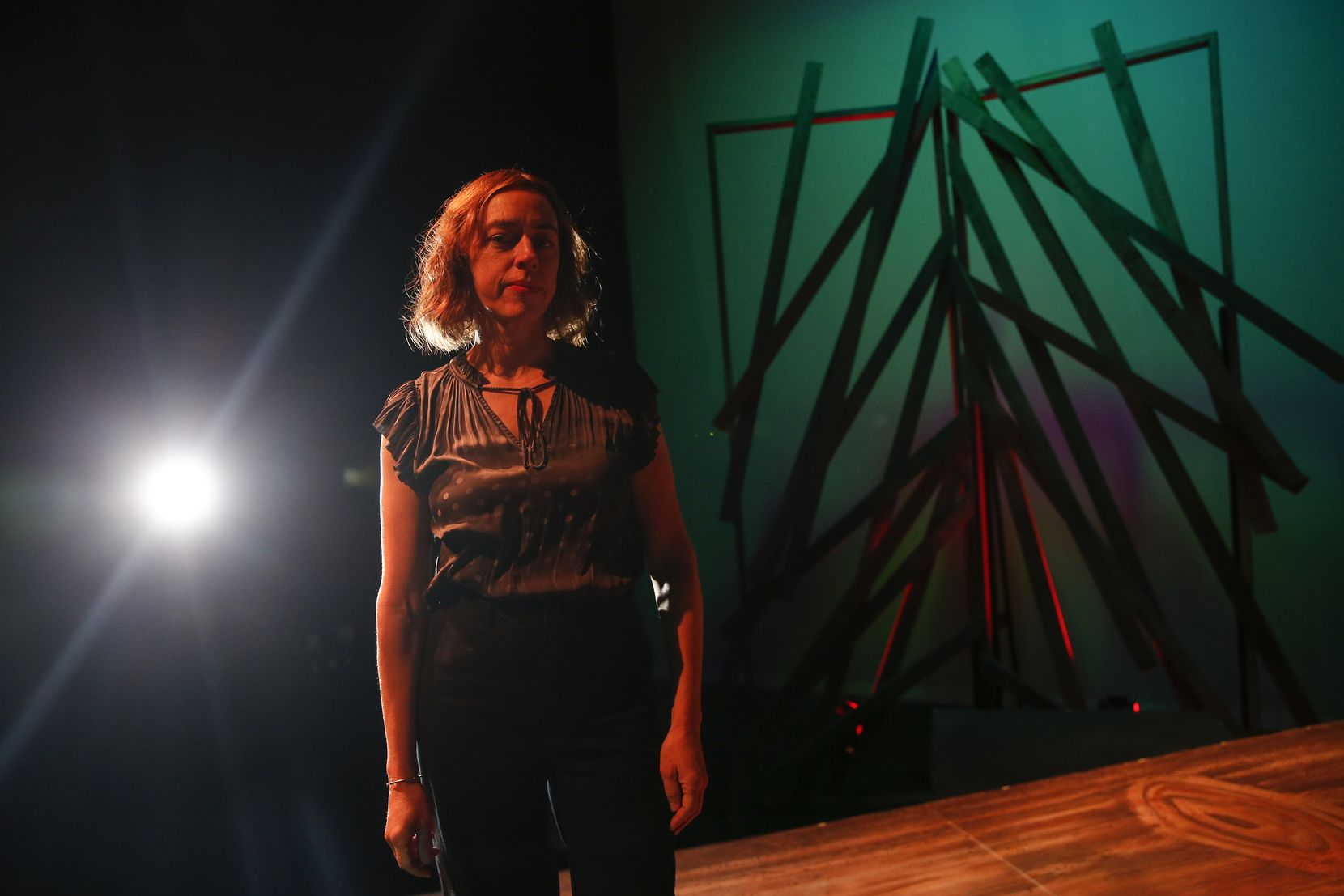 Sara Cardona, executive director of Teatro Dallas, on the stage of the Latino Cultural Center, where her company has found a permanent home. (Ryan Michalesko/The Dallas Morning News)
