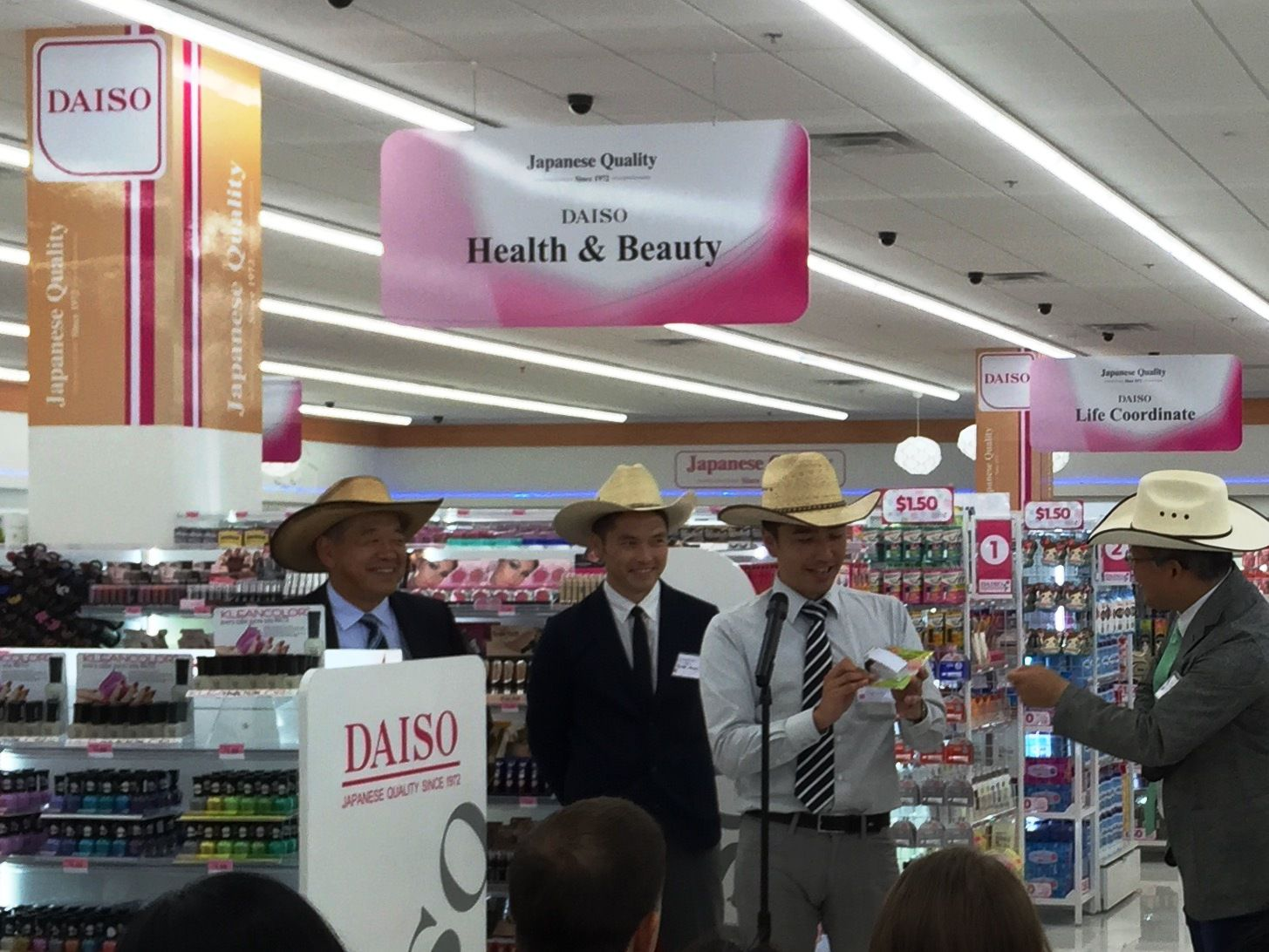 Daiso officials held a press conference at their new store opening in Carrollton Friday, July 31, 2015. They're wearing hats from the store's accessories aisle. Pictured left to right are Yoshi Murata, senior vice president, Ryuta Kamei, Toyo Sugisaki and Masayoshi Naito, president of Daiso Holding U.S.A. (DMN staff photo Maria Halkias)