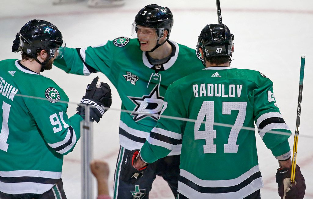 The Dallas Stars' Tyler Seguin (91) celebrates his goal with teammates John Klingberg (3) and Alexander Radulov (47) during the first period against Edmonton Oilers at American Airlines Center in Dallas on Saturday, Jan. 6, 2018. The Stars won, 5-1. (Jae S. Lee/Dallas Morning News/TNS)