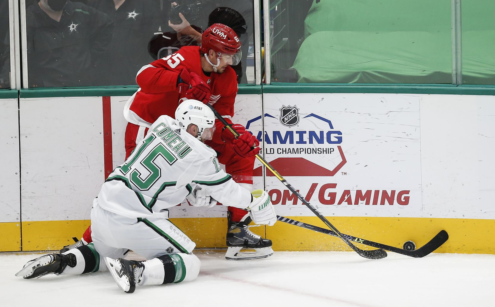 Dallas Stars forward Blake Comeau (15) battles Detroit Red Wings defenseman Danny DeKeyser (65) for the puckduring the first period of an NHL hockey game in Dallas, Monday, April 19, 2021. (Brandon Wade/Special Contributor)