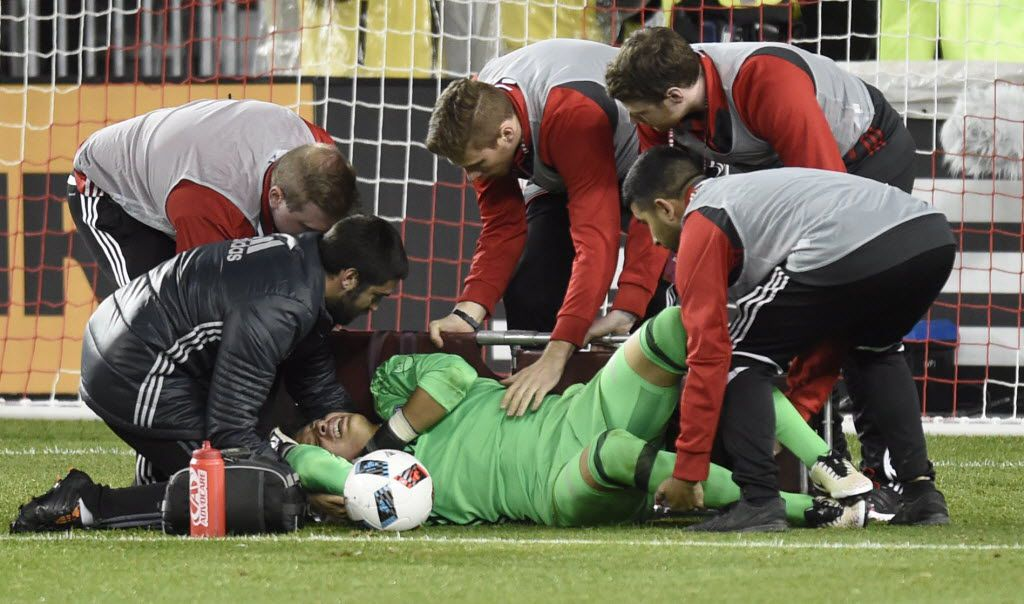 FC Dallas keeper Jesse Gonzalez is helped on onto a stretcher by members of the medical staff after Toronto FC's Will Johnson collided with him while chasing for a loose ball during the first half of an MLS soccer match in Toronto on Saturday, May 7, 2016. (Frank Gunn/The Canadian Press via AP)