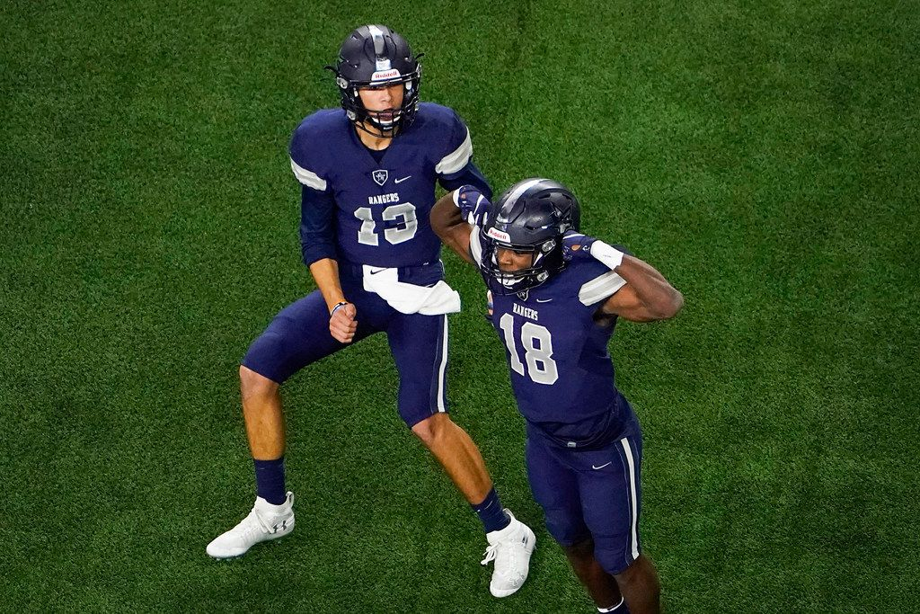 Frisco Lone Star wide receiver Marvin Mims (18) celebrates with quarterback Garret Rangel (13) after they connected on an 11-yard touchdown during the first half of a Class 5A Division I Region II semifinal playoff football game against Highland Park at AT&T Stadium non Friday, Nov. 29, 2019, in Arlington.
