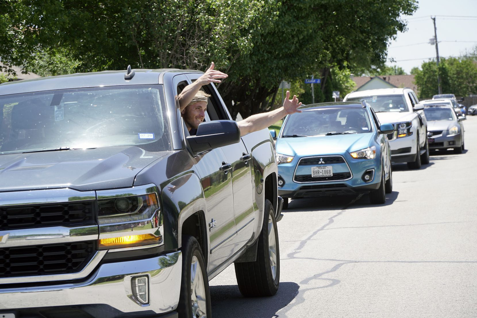 International Leadership of Texas faculty and students did a drive-by parade to celebrate the school's valedictorian Amanpreet Chahal and salutatorian Greta Romero at their homes in Mansfield and Arlington, Texas, on Wednesday, May 6, 2020. The well-wishers blew their horns and gave air hugs.