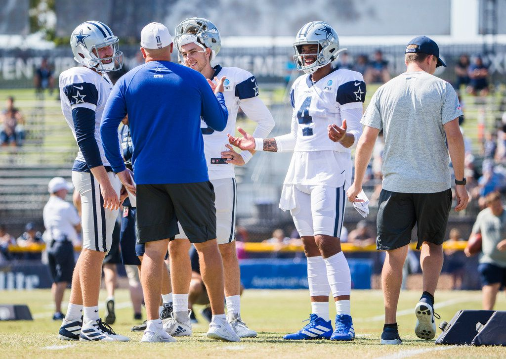 Dallas Cowboys quarterback Cooper Rush (7), quarterback Mike White (3) and quarterback Dak Prescott (4) talk with quarterback coach Jon Kitna during an afternoon practice at training camp in Oxnard, California on Wednesday, August 7, 2019. (Ashley Landis/The Dallas Morning News)