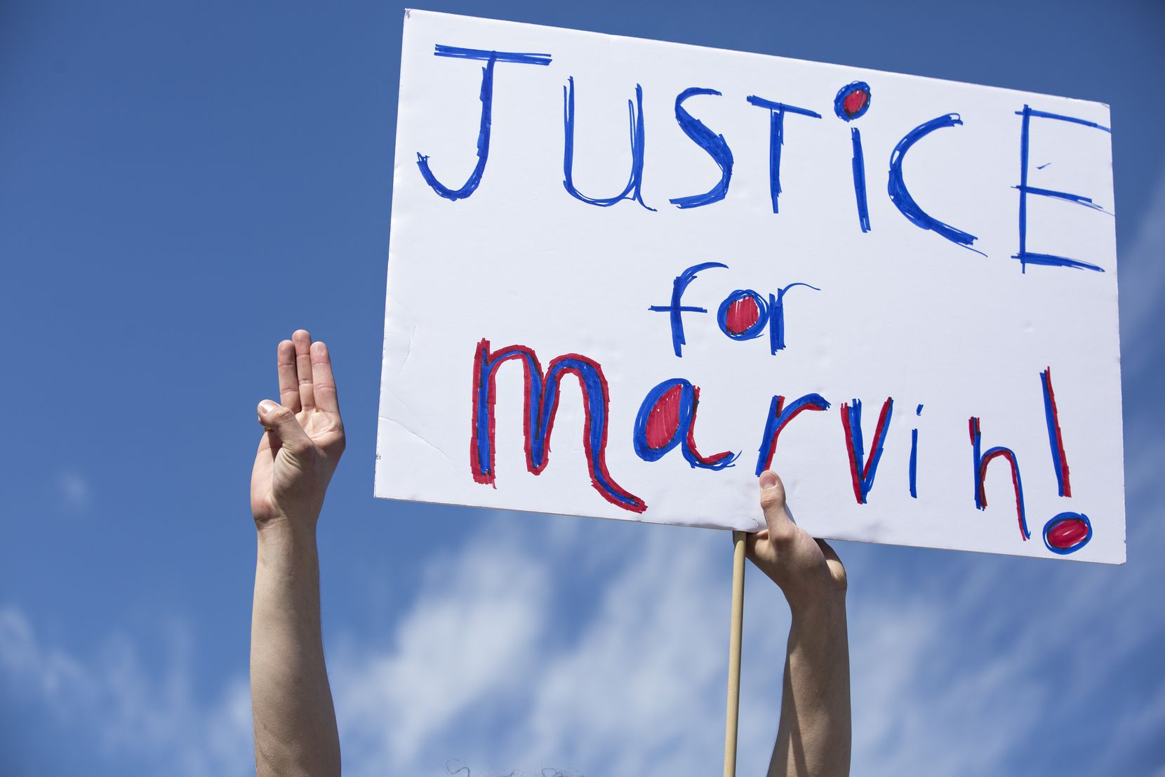 People marched through the Allen Premium Outlets on March 21, demanding justice for Marvin D. Scott III.