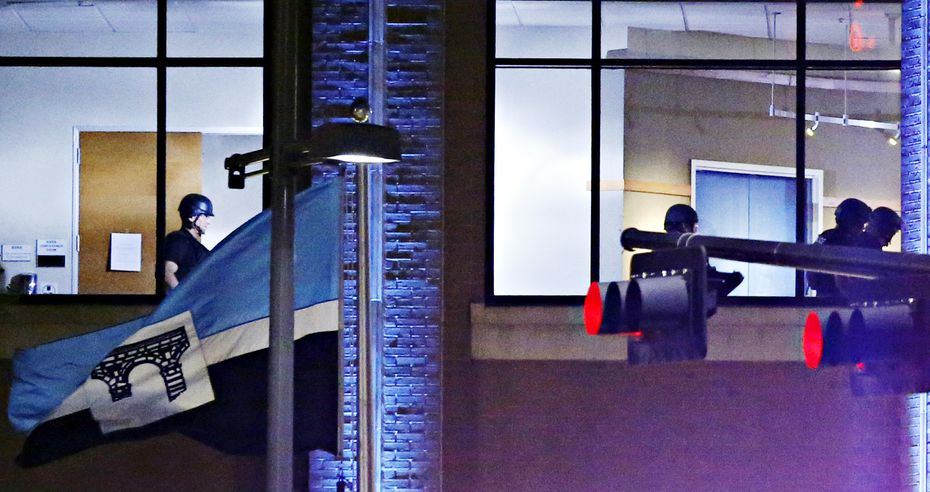 Dallas Police SWAT team members walk on the second floor of El Centro College, early in the morning of July 8, close to the time that an explosion was heard in the building, following a deadly shooting Friday, July 7, 2016 in Dallas. Micah Johnson was killed by explosives in the building.