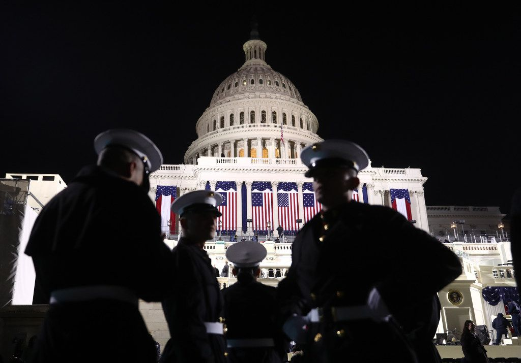 Marines stand in front of the U.S. Capitol building ahead of the 58th presidential inauguration in Washington, D.C., U.S., on Friday, Jan. 20, 2017. Donald Trump is the first president since the dawn of national polling in the late 1930s to enter office with the approval of fewer than half of Americans -- in his case only 40 percent. Photographer: Andrew Harrer/Bloomberg