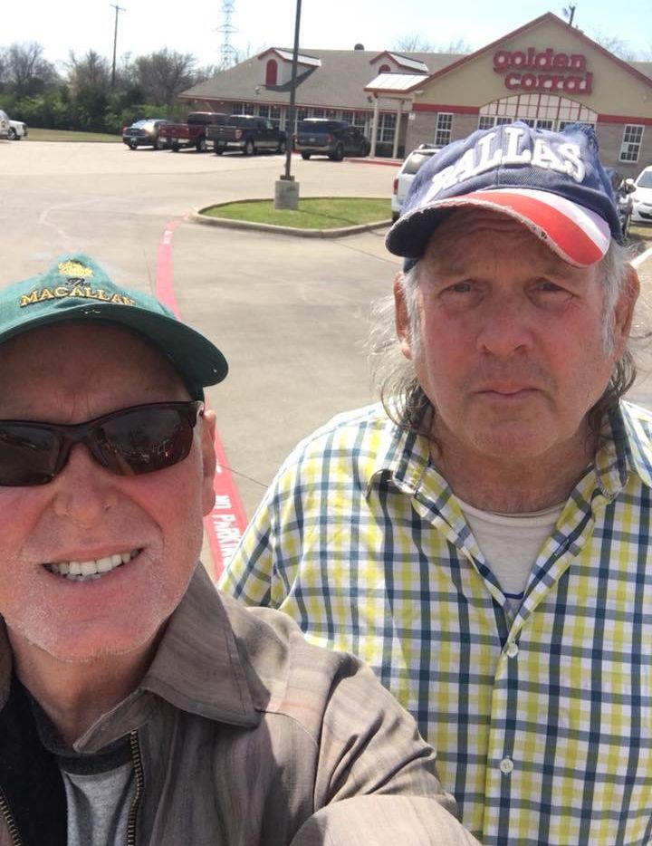 The author, Rawlins Gilliland, left, takes Charles, right, to Golden Corral for lunch.