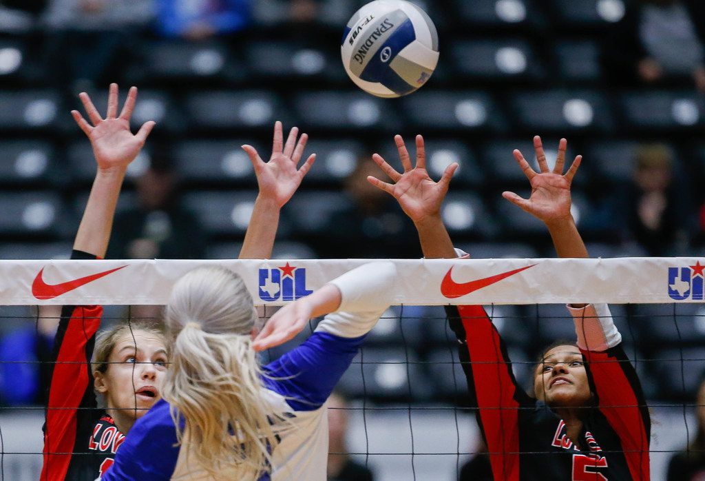 Grace Milliken (10) and Cecily Bramschreiber (5) attempt to block FriendswoodÕs Makensy Manbeck (7) hit during the first set of a class 5A volleyball state semifinal match at the Curtis Culwell Center in Garland, on Friday, November 22, 2019. Lovejoy won the first set 25-15. (Juan Figueroa/The Dallas Morning News)