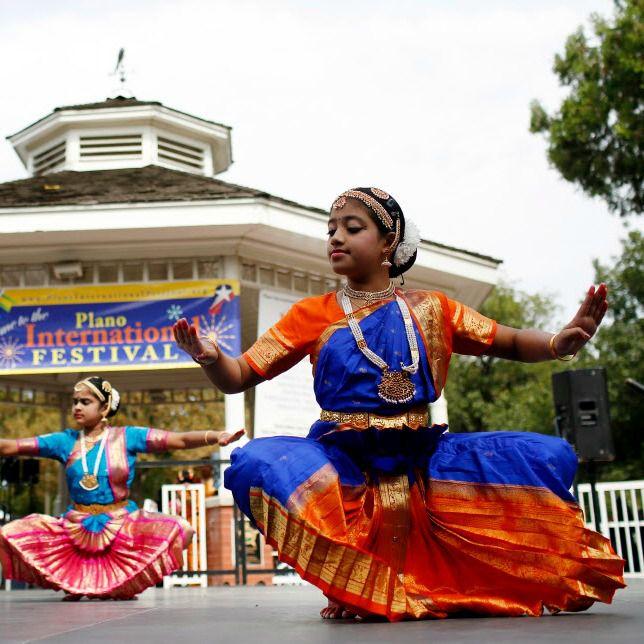 Members of the Kalarpan Bharatanatyam Dance School performs during the Plano International Festival.