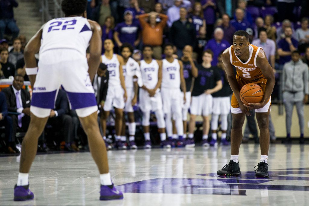 TCU Horned Frogs guard RJ Nembhard (22) watches as Texas Longhorns guard Matt Coleman III (2) waits out the clock during the second half of an NCAA men's basketball game between the University of Texas and TCU on Wednesday, January 29, 2020 at Schollmaier Arena on the TCU campus in Fort Worth. TCU lost 62-61.