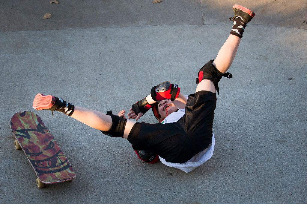 Travis Haley, 9, laughs as he takes a fall from his skateboard at Lively Pointe Skate Park on Sunday, Jan. 22, 2017, in Irving. (Smiley N. Pool/The Dallas Morning News)