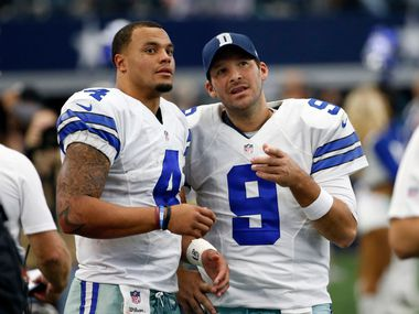In a Sunday, Nov. 20, 2016 file photo, Dallas Cowboys' Dak Prescott (4) and Tony Romo (9) talk on the sideline in the first half of an NFL football game against the Baltimore Ravens in Arlington, Texas. The Cowboys went on a record-setting run without quarterback Romo, thanks to a pair of star rookies, Dak Prescott and Ezekiel Elliott.