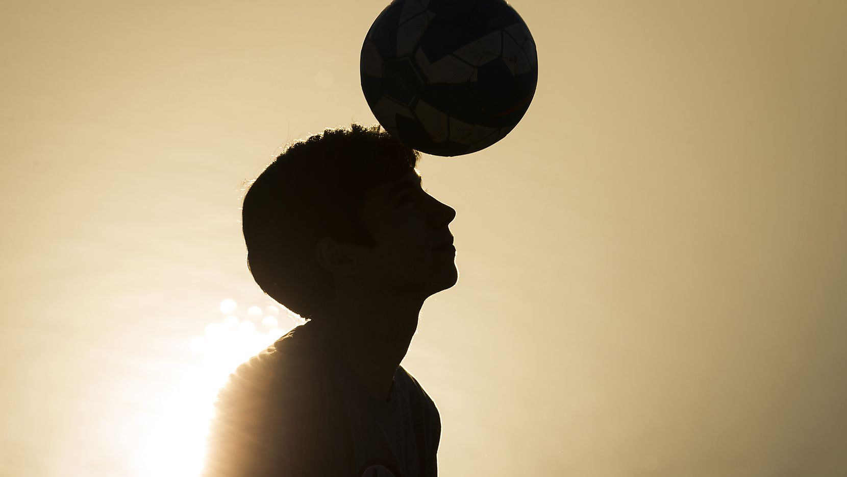 Dallas Morning News file photo, 2015: Nicolas Reyes, 13, heads a soccer ball at a park near his home on Monday, Dec. 14, 2015, in Coppell. Reyes got a concussion playing soccer in October and had to miss school and stop playing sports so he could recover. He was recently cleared to return to normal activities and is participating in a UT Southwestern registry of brain injuries.  Researchers hope the registry will help them learn more about concussions, and how some people recover sooner or show fewer symptoms than others. (Smiley N. Pool/The Dallas Morning News)