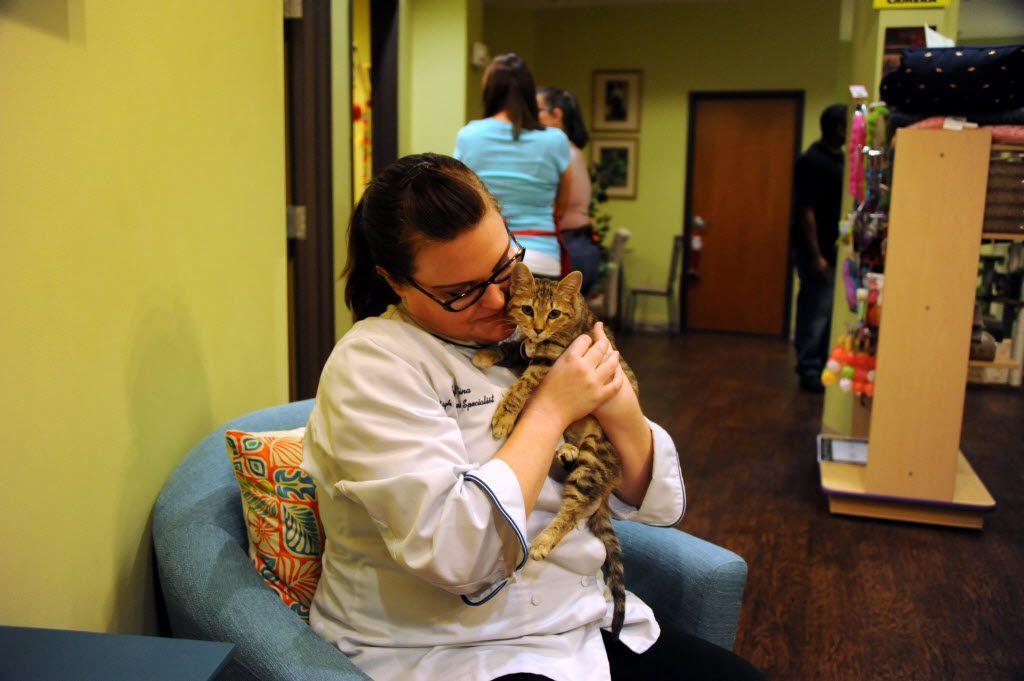 Gina Gandy holds Hottie MacNaughty at the Charming Cat Corner.