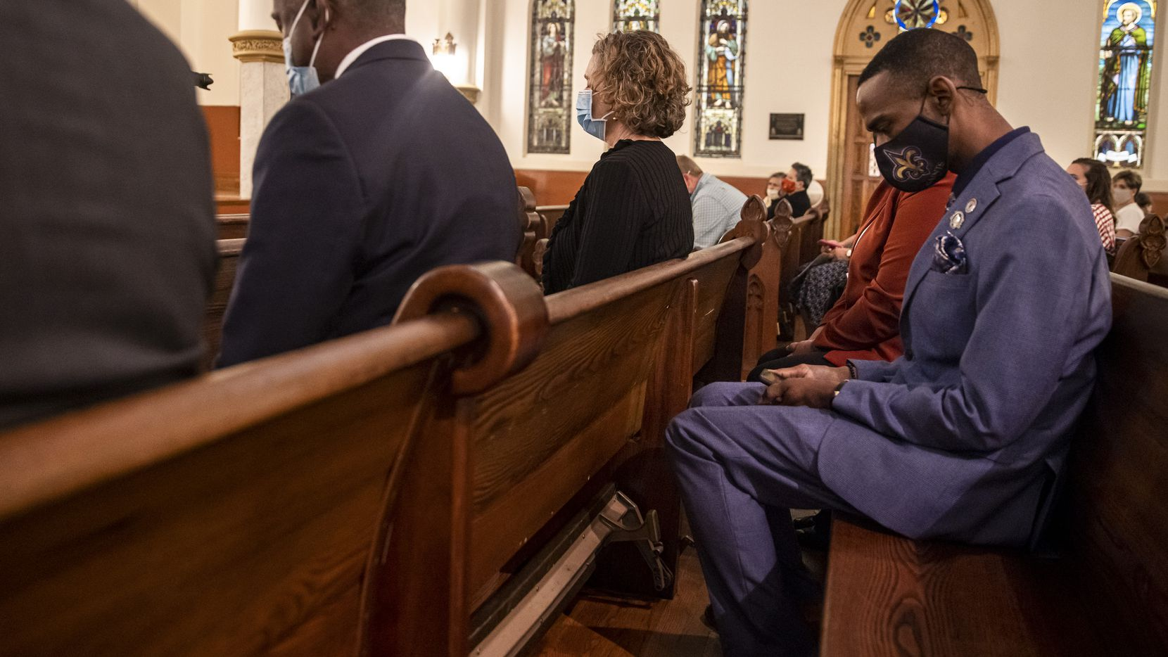Darrell Herbert bows his head in prayer during the Mass for Healing held on the one-year anniversary of George Floyd's death on Tuesday, May 25, 2021, at Cathedral Guadalupe in Dallas. New research shows that DFW residents see a role for Christian communities in caring for people in need of help, but less support for religious involvement in systemic reforms. (Lynda M. González/The Dallas Morning News)