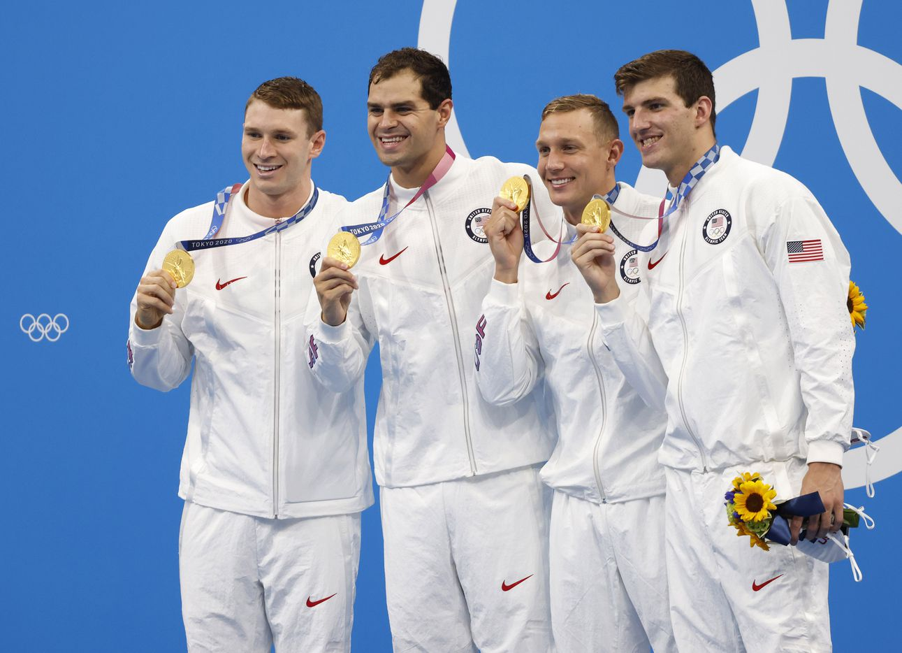 (Left to right) USA's Ryan Murphy, Michael Andrew, Caeleb Dressel, and Zach Apple pose for photos during the men's 4x100 meter medley relay medal ceremony at the postponed 2020 Tokyo Olympics at Tokyo Aquatics Centre, on Sunday, August 1, 2021, in Tokyo, Japan. USA earned a gold medal, setting a new world record with a time of 3:26.78. (Vernon Bryant/The Dallas Morning News)