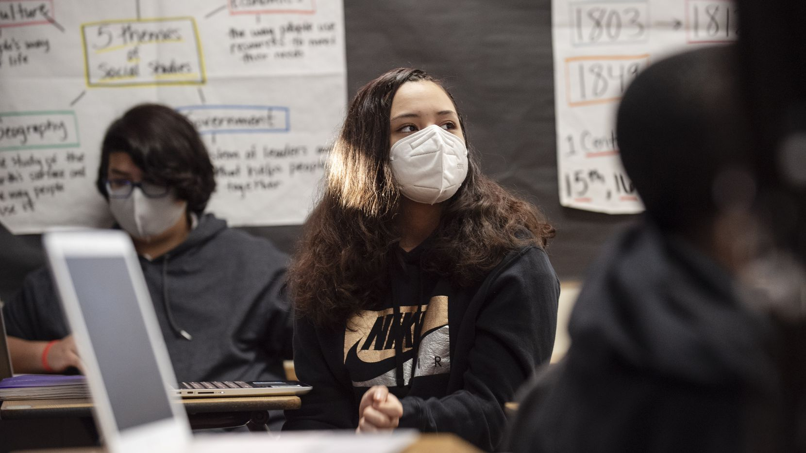 Eighth grader Yarettzi Chavez wears a face mask as she participates during a class discussion on the Presidential candidates and the election, on Wednesday, Nov. 04, 2020 at Permenter Middle School in Cedar Hill.
