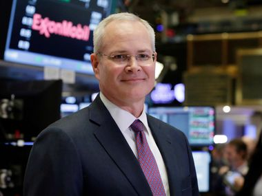 Exxon Mobil Corporation Chairman & CEO Darren Woods poses for a photo on the floor of the New York Stock Exchange, Wednesday, March 1, 2017. Woods succeeded Rex Tillerson, following Tillerson's nomination by President Donald Trump to be the next United States Secretary of State. (AP Photo/Richard Drew)