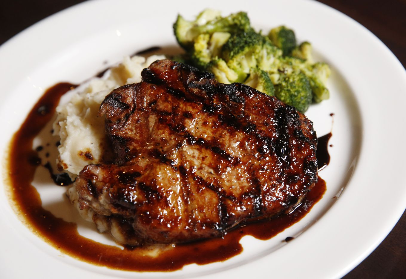 Dr Pepper pork chop dish at Daylight Golf on Thursday, January 21, 2021in Grapevine, Texas. The sports bar restaurant features virtual golf.