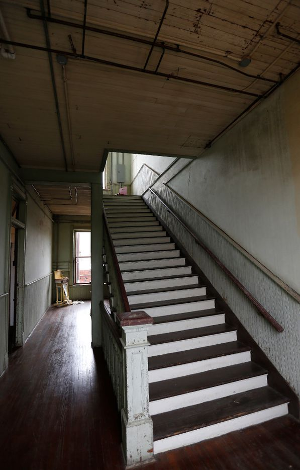 A stairway to the third floor at the 100 West. The Odd Fellows used the third floor as a gathering and performance space for private ritual events. Today,  the third floor is used as studio space and a place to host small dinners.