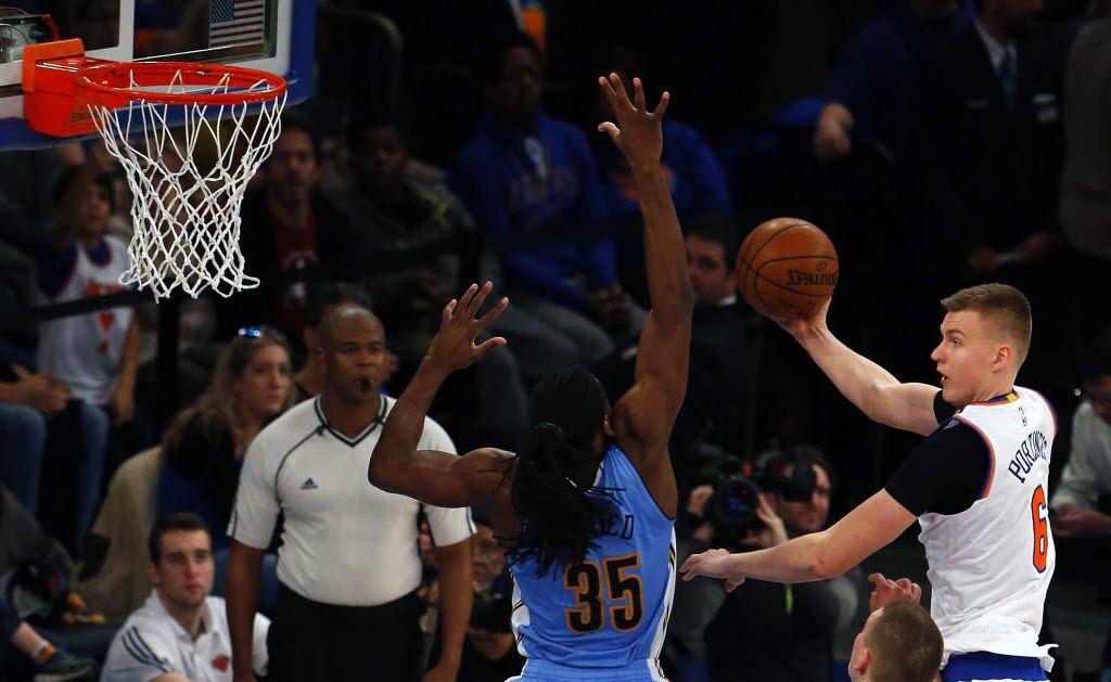Denver Nuggets forward Kenneth Faried (35) defends against New York Knicks forward Kristaps Porzingis (6) during second half at Madison Square Garden. The Denver Nuggets defeated the New York Knicks 101-96.