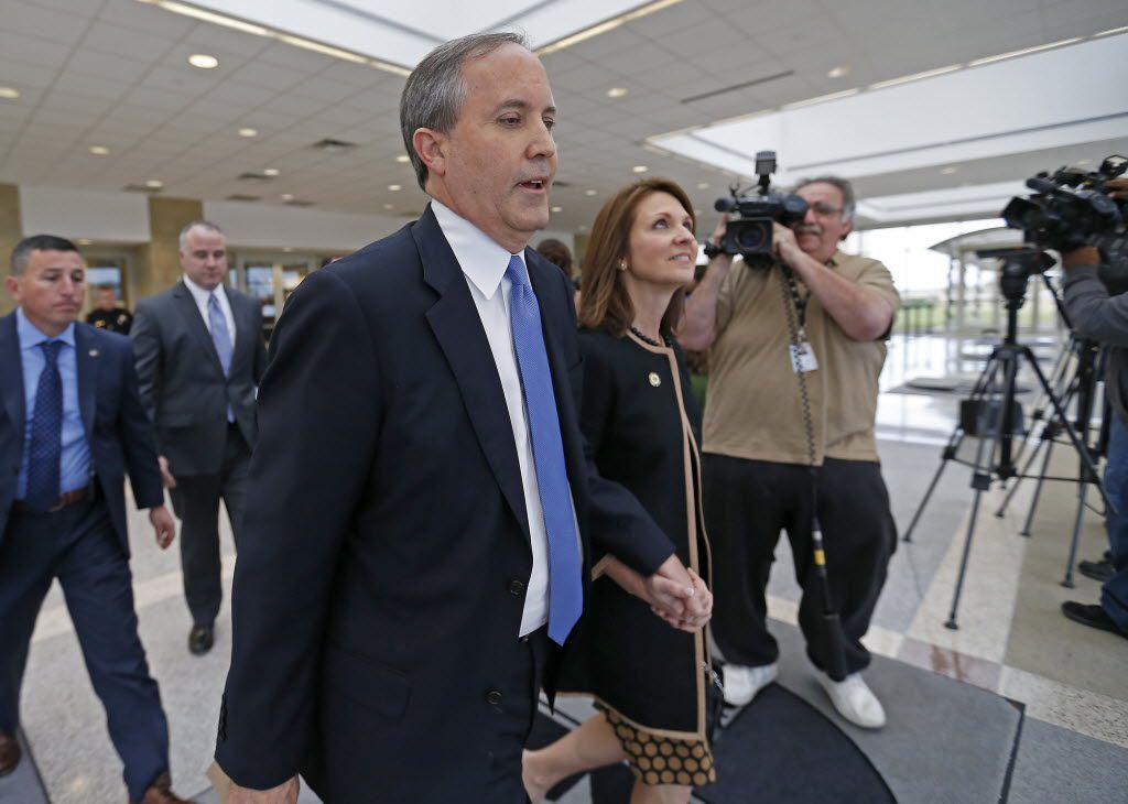 Texas Attorney General Ken Paxton, left, and his wife, Angela, leave the Collin County courthouse after his pretrial motion hearing on Tuesday, Dec. 1, 2015, in McKinney, Texas.