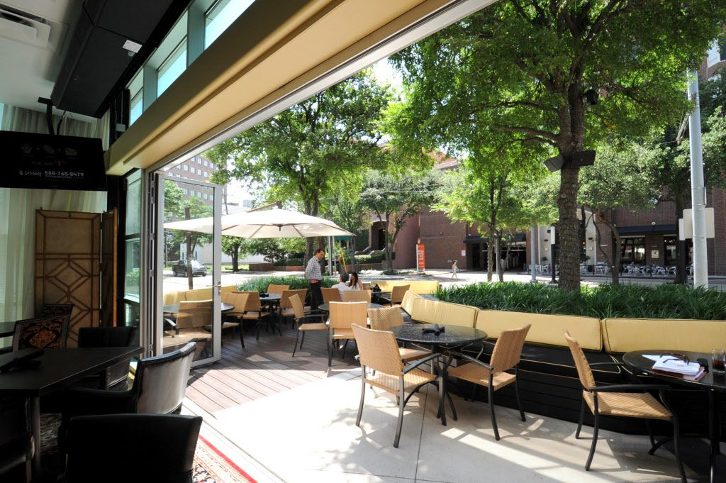 Large doors connect the interior to the patio during the summer and spring at Patrizio in Dallas.