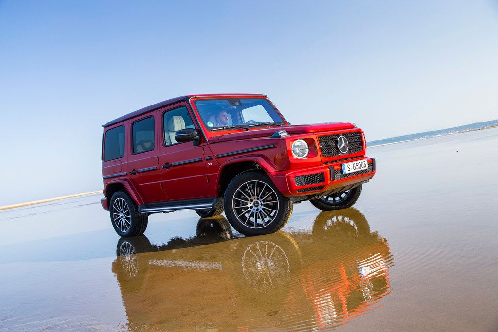 "The newly redesigned Mercedes-Benz G 500, in hyacinth red metallic. One of the newly redesigned features is the suspension, with Dynamic Select driving modes, the ""G-Mode"" and the three 100-percent differential locks to enhance ride comfort and agility on any surface."