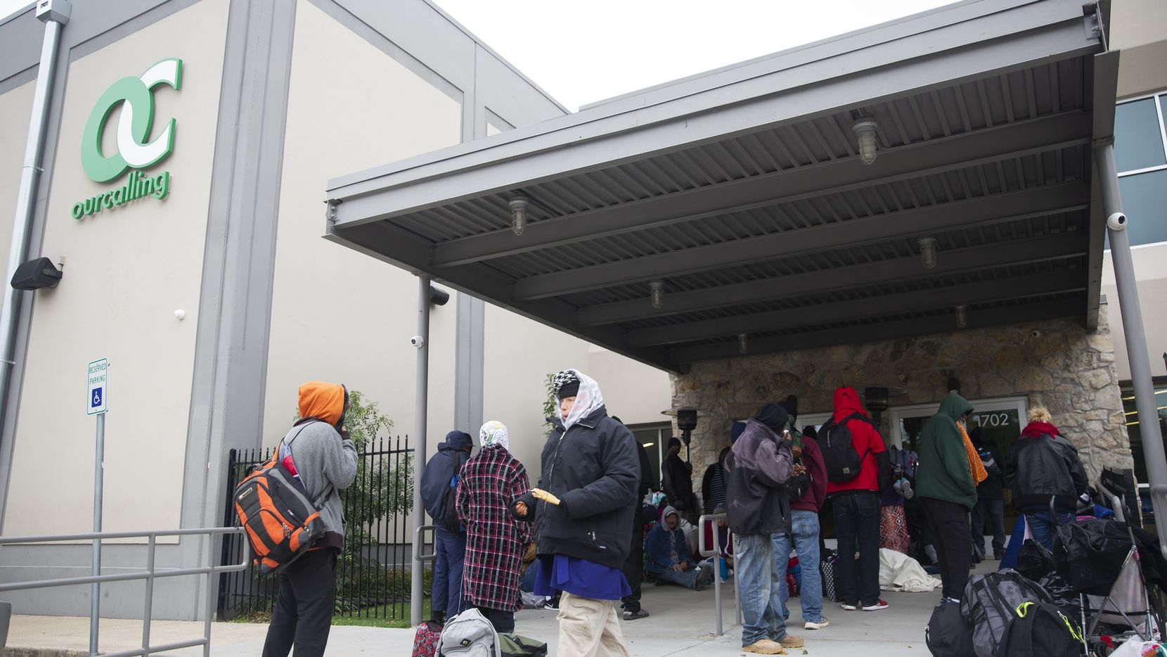 People wait outside of OurCalling, a faith-based organization, ahead of tonight's freeze on Nov. 11, 2019 in Dallas. An update to city code will allow OurCalling to operate as an emergency shelter over the next several days.