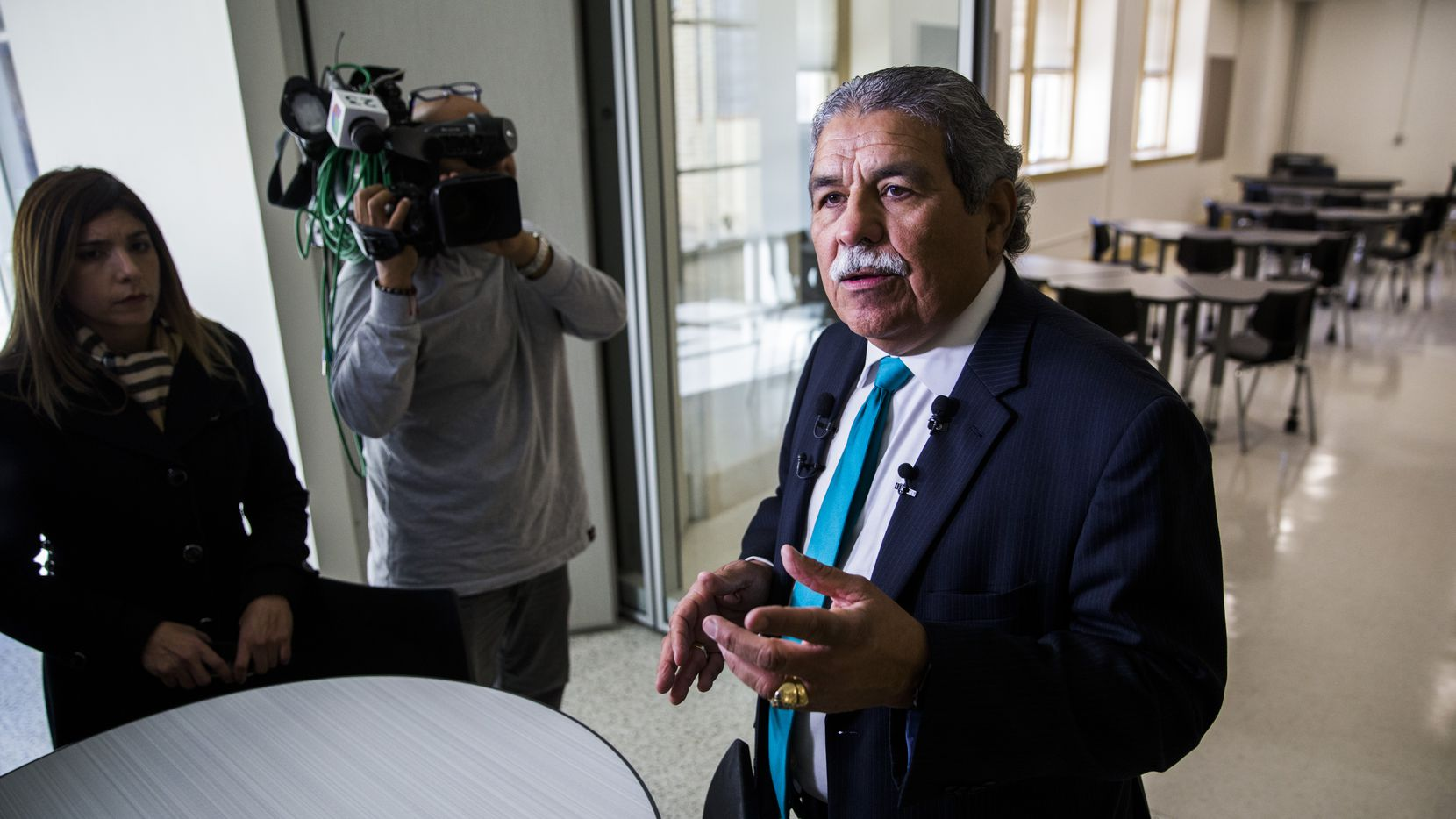Dallas ISD Superintendent Michael Hinojosa (right) talks about classroom space to reporters on Thursday, December 19, 2019 at South Oak Cliff High School in Dallas. It was part of a two-year, $52 million renovation to the campus. (Ashley Landis/The Dallas Morning News)