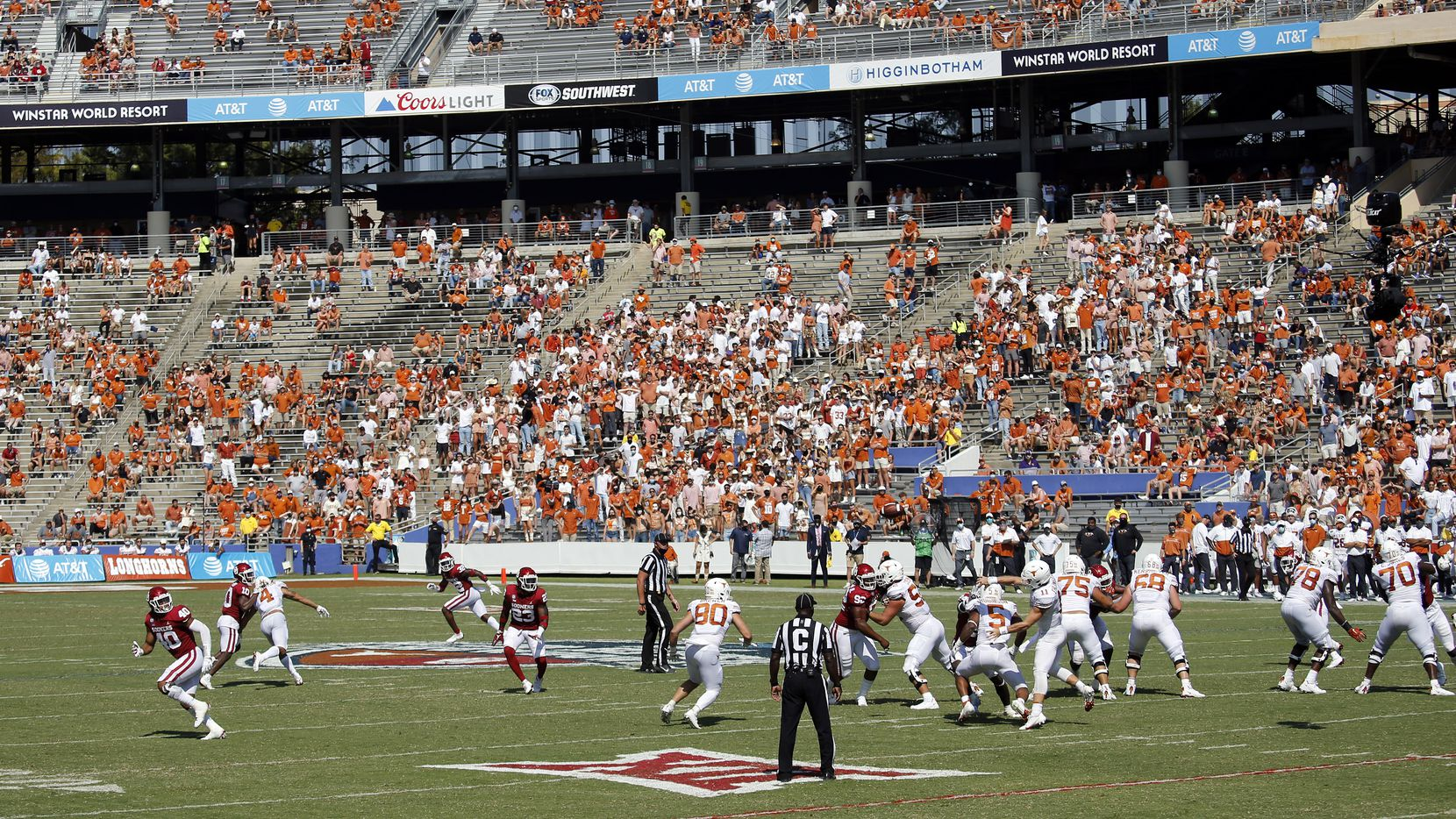 FILE - The Texas offense is pictured here against the Oklahoma defense during the Red River Showdown at the Cotton Bowl in Dallas on Saturday, Oct. 10, 2020.