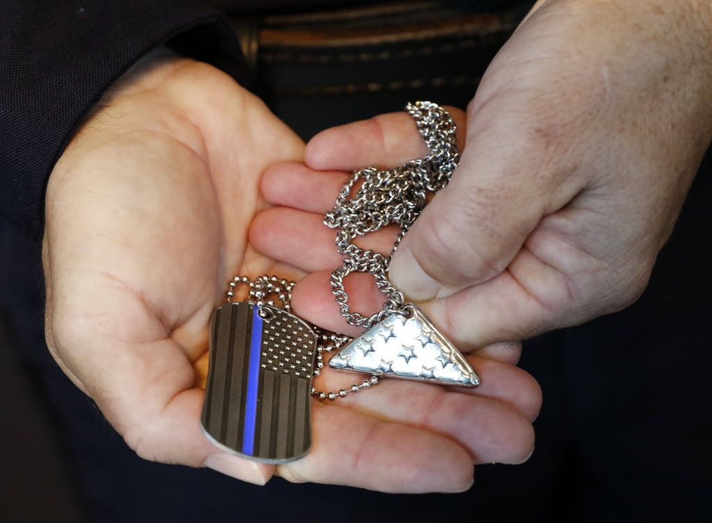 Executive Assistant Chief David Pughes accepted Thin Blue Line silver Scripture-inscribed Shields of Strength and flag necklaces on behalf of DPD at Jack Evans Police Headquarters on Friday. (David Woo/Staff Photographer)
