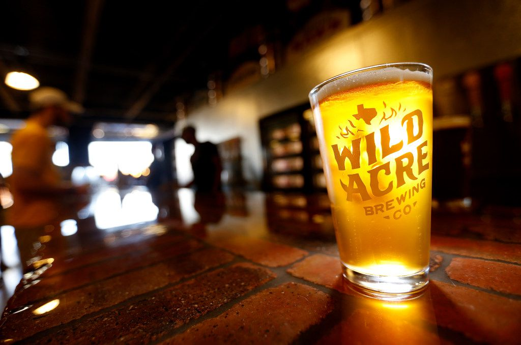 A glass of Moonlight Shine beer made by Wild Acre Brewing Co. sits on the bar in the taproom in Fort Worth, Texas, Friday, Sept. 30, 2016.