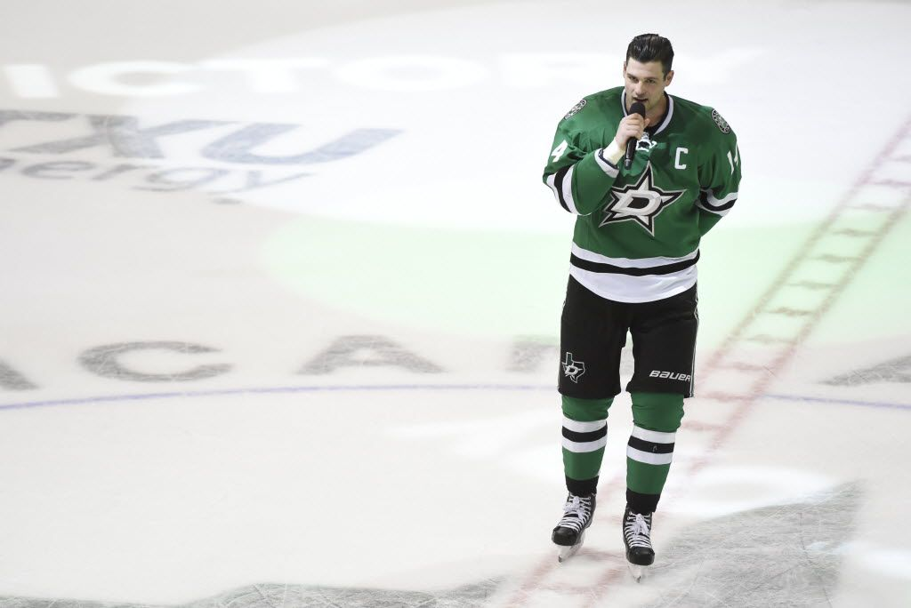 Dallas Stars left wing Jamie Benn (14) talks to fans after an NHL hockey game on Saturday, April 9, 2016, in Dallas. The Stars defeated the Predators 3-2 to win the central division. (AP Photo/Michael Ainsworth)