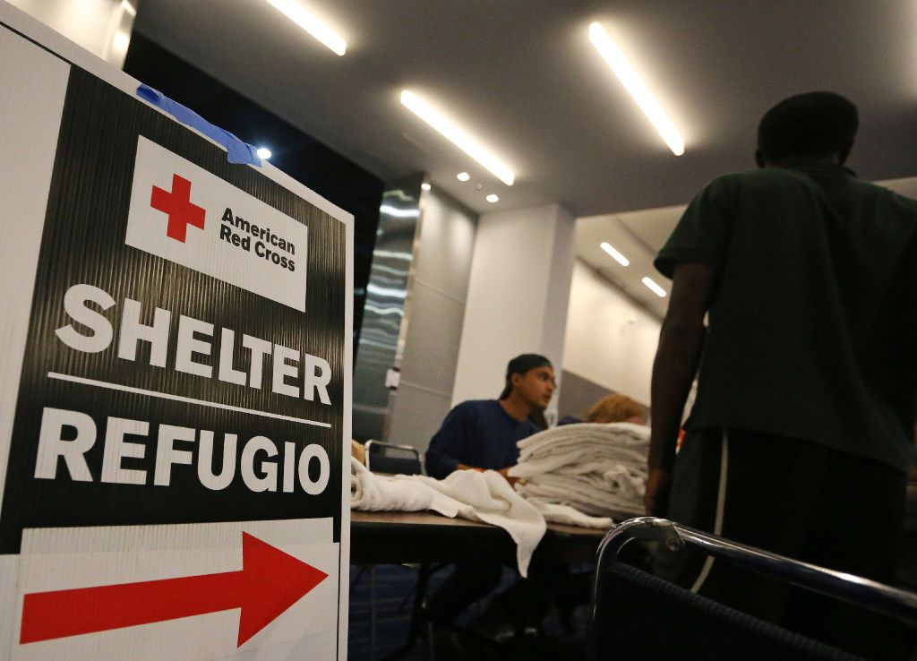 Signs show storm evacuees the way to the Red Cross shelter at the George R. Brown Convention Center in  Houston.