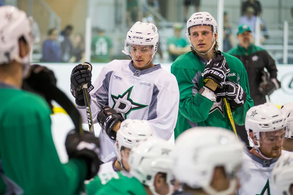 Defenseman Miro Heiskanen (center) and forward Roope Hintz (right) listen to instruction on the first day of Dallas Stars development camp at the Dr Pepper StarCenter on Saturday, July 8, 2017, in Frisco.