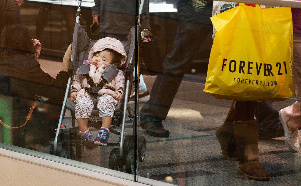 Ella Nguyen, left, takes a break with her daughter, Karen Nguyen, 1, while shopping at Galleria Dallas on Black Friday, November 25, 2016 in Dallas, Texas. (David Woo/The Dallas Morning News)