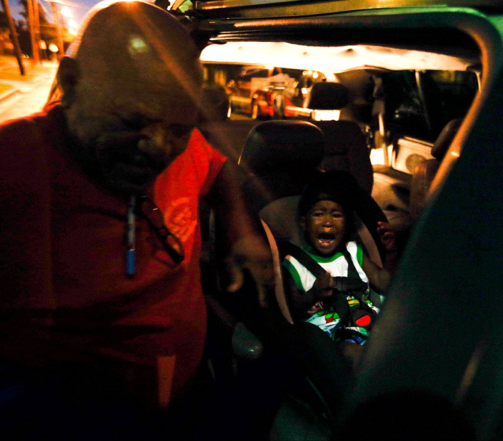 After weeks of not leaving his father's side, Jordan Miller, 2, cries when he leaves The Family Place's men's shelter for his first day of day care in Dallas. (Tailyr Irvine/The Dallas Morning News)