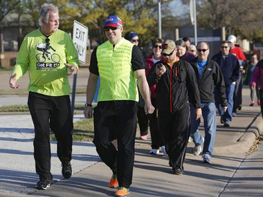 Grand Prairie Mayor Ron Jensen (left) is pictured in a file photo on a Strollin' with the Mayor event in 2019. The mayor will restart his similar Cyclin' with the Mayor event next week.