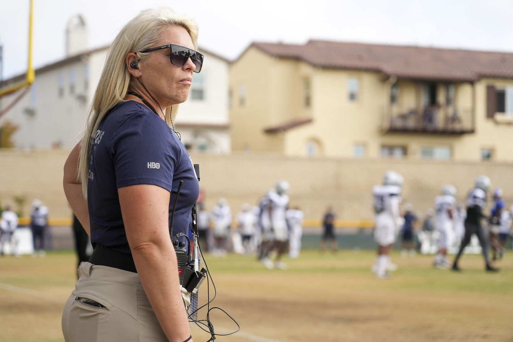 Shannon Furman of HBO's Hard Knocks watches during a joint practice between the Dallas Cowboys and the Los Angeles Rams at training camp on Saturday, Aug. 7, 2021, in Oxnard, Calif.