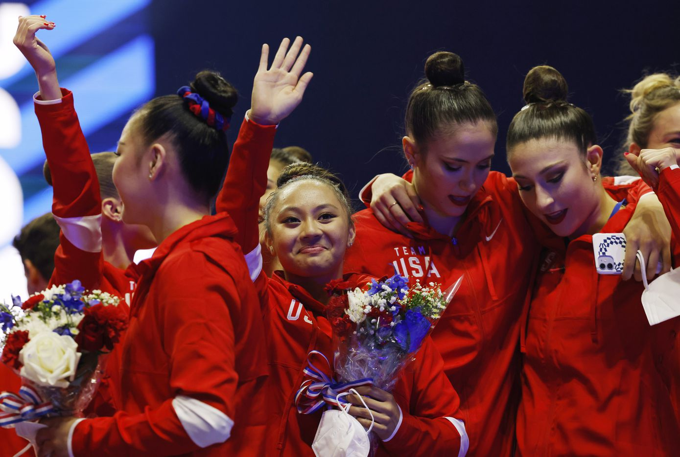 Emma Malabuyo waves to people in the crowd after the women's U.S. Olympic gymnastics team was announced during day 2 of the women's 2021 U.S. Olympic Trials at The Dome at America's Center on Sunday, June 27, 2021 in St Louis, Missouri.(Vernon Bryant/The Dallas Morning News)